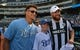 Jun 7, 2019; Kansas City, MO, USA; Kansas City Chiefs quarterback Patrick Mahomes (left) and wide receiver Travis Kelce (right) pose for a photo with ceremonial pitch kid Charlie Walsh before the Big Slick celebrity softball game at Kauffman Stadium. Mandatory Credit: Denny Medley-USA TODAY Sports