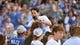 Jun 7, 2019; Kansas City, MO, USA; Movie and television Paul Rudd is hoisted by his team as he talks with fans after the Big Slick celebrity softball game at Kauffman Stadium. Mandatory Credit: Denny Medley-USA TODAY Sports