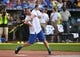 Jun 7, 2019; Kansas City, MO, USA; Movie and television actor Paul Rudd bats during the Big Slick celebrity softball game at Kauffman Stadium. Mandatory Credit: Denny Medley-USA TODAY Sports