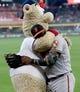 "Jun 9, 2019; Houston, TX, USA; Baltimore Orioles third baseman Hanser Alberto (57) gets a hug from Atlanta Braves mascot \""Blooper\"" during \""Orbits\"" birthday celebration before playing against the Baltimore Orioles at Minute Maid Park. Mandatory Credit: Thomas B. Shea-USA TODAY Sports"