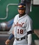 Jun 12, 2019; Kansas City, MO, USA; Detroit Tigers third baseman Dawel Lugo (18) prepares in the dugout before the game against the Kansas City Royals at Kauffman Stadium. Mandatory Credit: Denny Medley-USA TODAY Sports