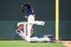 Jun 15, 2019; Minneapolis, MN, USA; Minnesota Twins first baseman C.J. Cron (24) makes a catch while Kansas City Royals right fielder Whit Merrifield (15) slides safely back to first base at Target Field. Mandatory Credit: David Berding-USA TODAY Sports