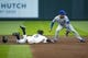 Jun 17, 2019; Seattle, WA, USA; Seattle Mariners center fielder Mallex Smith (0) slides safely for a double before Kansas City Royals second baseman Nicky Lopez (1) can apply a tag during the first inning at T-Mobile Park. Mandatory Credit: Joe Nicholson-USA TODAY Sports