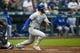 Jun 17, 2019; Seattle, WA, USA; Kansas City Royals left fielder Alex Gordon (4) hits a single against the Seattle Mariners during the third inning at T-Mobile Park. Mandatory Credit: Joe Nicholson-USA TODAY Sports