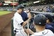 Jun 17, 2019; Seattle, WA, USA; Seattle Mariners catcher Tom Murphy (2) is greeted in the dugout after scoring a run against the Kansas City Royals during the fourth inning at T-Mobile Park. Mandatory Credit: Joe Nicholson-USA TODAY Sports
