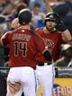 Jun 23, 2019; Phoenix, AZ, USA; Arizona Diamondbacks catcher Caleb Joseph (14) slaps hands Arizona Diamondbacks right fielder David Peralta (6) after scoring a run against the San Francisco Giants during the third inning at Chase Field. Mandatory Credit: Joe Camporeale-USA TODAY Sports
