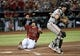 Jun 23, 2019; Phoenix, AZ, USA; Arizona Diamondbacks catcher Caleb Joseph (14) slides and beats a throw to San Francisco Giants catcher Stephen Vogt (21) during the third inning at Chase Field. Mandatory Credit: Joe Camporeale-USA TODAY Sports