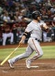 Jun 23, 2019; Phoenix, AZ, USA; San Francisco Giants catcher Stephen Vogt (21) hits an RBI ground out against the Arizona Diamondbacks during the fourth inning at Chase Field. Mandatory Credit: Joe Camporeale-USA TODAY Sports