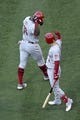 Jun 26, 2019; Anaheim, CA, USA; Cincinnati Reds right fielder Yasiel Puig (66) celebrates with shortstop Jose Iglesias (4) after hitting a solo home run during the fifth inning against the Los Angeles Angels at Angel Stadium of Anaheim. Mandatory Credit: Kelvin Kuo-USA TODAY Sports