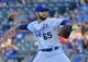 Jul 2, 2019; Kansas City, MO, USA; Kansas City Royals starting pitcher Jakob Junis (65) delivers a pitch against the Cleveland Indians during the first inning at Kauffman Stadium. Mandatory Credit: Peter G. Aiken/USA TODAY Sports
