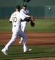 Jul 3, 2019; Oakland, CA, USA; Oakland Athletics first baseman Matt Olson (28) tosses the ball to pitcher Mike Fiers covering first base on an infield grounder by Minnesota Twins Luis Arraez during the second inning at Oakland Coliseum. Mandatory Credit: D. Ross Cameron-USA TODAY Sports