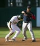 Jul 3, 2019; Oakland, CA, USA; Minnesota Twins second baseman Jonathan Schoop (16) throws over Oakland Athletics Robbie Grossman to complete a double play during the second inning at Oakland Coliseum. Josh Phegley was out at first. Mandatory Credit: D. Ross Cameron-USA TODAY Sports