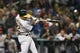Jul 5, 2019; Seattle, WA, USA; Oakland Athletics center fielder Ramon Laureano (22) hits an RBI-sacrifice fly against the Seattle Mariners during the seventh inning at T-Mobile Park. Mandatory Credit: Joe Nicholson-USA TODAY Sports