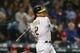 Jul 5, 2019; Seattle, WA, USA; Oakland Athletics designated hitter Khris Davis (2) hits a single against the Seattle Mariners during the seventh inning at T-Mobile Park. Mandatory Credit: Joe Nicholson-USA TODAY Sports