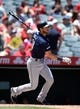 July 14, 2019; Anaheim, CA, USA; Seattle Mariners first baseman Austin Nola (23) hits a solo home run against the Los Angeles Angels during the second inning at Angel Stadium of Anaheim. Mandatory Credit: Gary A. Vasquez-USA TODAY Sports