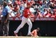 July 14, 2019; Anaheim, CA, USA; Los Angeles Angels catcher Dustin Garneau (13) scores a run on a bases loaded walk against the Seattle Mariners during the fifth inning at Angel Stadium of Anaheim. Mandatory Credit: Gary A. Vasquez-USA TODAY Sports