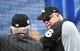 Jul 15, 2019; Kansas City, MO, USA; Chicago White Sox manager Rick Renteria (right) watches batting practice before a game against the Kansas City Royals at Kauffman Stadium. Mandatory Credit: Denny Medley-USA TODAY