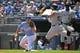 Jul 18, 2019; Kansas City, MO, USA; Chicago White Sox third baseman Yoan Moncada (10) beats the throw to first during the first inning against Kansas City Royals first baseman Cheslor Cuthbert (19) at Kauffman Stadium. Mandatory Credit: Peter G. Aiken/USA TODAY Sports