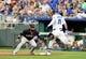 Jul 25, 2019; Kansas City, MO, USA; Cleveland Indians first baseman Carlos Santana (41) cannort make the out as Kansas City Royals right fielder Bubba Starling (11) beats the throw to first base in the third inning at Kauffman Stadium. Mandatory Credit: Denny Medley-USA TODAY Sports