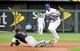 Jul 25, 2019; Kansas City, MO, USA; Kansas City Royals second baseman Whit Merrifield (15) picks off Cleveland Indians third baseman Jose Ramirez (11) at second base in the fourth inning at Kauffman Stadium. Mandatory Credit: Denny Medley-USA TODAY Sports
