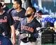 Jul 25, 2019; Kansas City, MO, USA; Cleveland Indians first baseman Carlos Santana (41) is congratulated in the dugout after scoring in the sixth inning against the Kansas City Royals at Kauffman Stadium. Mandatory Credit: Denny Medley-USA TODAY Sports