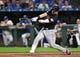 Jul 25, 2019; Kansas City, MO, USA; Cleveland Indians second baseman Jason Kipnis (22) hits an RBI single in the sixth inning against the Kansas City Royals at Kauffman Stadium. Mandatory Credit: Denny Medley-USA TODAY Sports