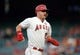 July 30, 2019; Anaheim, CA, USA; Los Angeles Angels center fielder Mike Trout (27) reaches third on a single hit by designated hitter Shohei Ohtani (17) during the first inning at Angel Stadium of Anaheim. Mandatory Credit: Gary A. Vasquez-USA TODAY Sports
