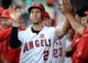 July 30, 2019; Anaheim, CA, USA; Los Angeles Angels shortstop Andrelton Simmons (2) is greeted after scoring a run off first baseman Matt Thaiss (23) two run home run against the Detroit Tigers during the second inning at Angel Stadium of Anaheim. Mandatory Credit: Gary A. Vasquez-USA TODAY Sports