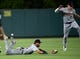 July 30, 2019; Anaheim, CA, USA; Detroit Tigers left fielder Victor Reyes (22) and center fielder JaCoby Jones (21) misplay a hit by Los Angeles Angels shortstop Andrelton Simmons (2) during the fifth inning at Angel Stadium of Anaheim. Mandatory Credit: Gary A. Vasquez-USA TODAY Sports
