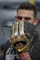Aug 5, 2019; Pittsburgh, PA, USA;  Pittsburgh Pirates  pitcher Joe Musgrove (59) models his glove which was recently painted by artist Cody Sabol in the style of the Marvel's Avengers: End Game Infinity Wars movie before the game against the Milwaukee Brewers at PNC Park. Mandatory Credit: Charles LeClaire-USA TODAY Sports