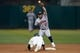 Aug 15, 2019; Oakland, CA, USA; Oakland Athletics left fielder Robbie Grossman (8) slides back to second base against Houston Astros second baseman Jose Altuve (27) during the fourth inning at the Oakland Coliseum. Mandatory Credit: Stan Szeto-USA TODAY Sports