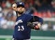 Aug 17, 2019; Washington, DC, USA; Milwaukee Brewers starting pitcher Jordan Lyles (23) throws against the Washington Nationals during the first inning at Nationals Park. Mandatory Credit: Brad Mills-USA TODAY Sports
