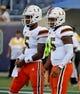 Aug 24, 2019; Orlando, FL, USA; Miami Hurricanes quarterback N'Kosi Perry (5) and quarterback Jarren Williams (15) warm up prior to the game against the Florida Gators at Camping World Stadium. Mandatory Credit: Jasen Vinlove-USA TODAY Sports