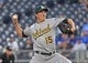 Aug 26, 2019; Kansas City, MO, USA; Oakland Athletics starting pitcher Homer Bailey (15) delivers a pitch during the first inning against the Kansas City Royals at Kauffman Stadium. Mandatory Credit: Peter G. Aiken