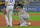 Aug 26, 2019; Kansas City, MO, USA; Oakland Athletics center fielder Mark Canha (20) slides into third base during the second inning against the Kansas City Royals at Kauffman Stadium. Mandatory Credit: Peter G. Aiken