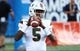Aug 24, 2019; Orlando, FL, USA; Miami Hurricanes quarterback N'Kosi Perry (5) works out prior to the game at Camping World Stadium. Mandatory Credit: Kim Klement-USA TODAY Sports