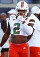Aug 24, 2019; Orlando, FL, USA; Miami Hurricanes defensive back Trajan Bandy (2) works out prior to the game at Camping World Stadium. Mandatory Credit: Kim Klement-USA TODAY Sports