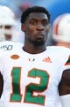 Aug 24, 2019; Orlando, FL, USA; Miami Hurricanes wide receiver Jeremiah Payton (12) works out prior to the game at Camping World Stadium. Mandatory Credit: Kim Klement-USA TODAY Sports