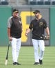 Sep 3, 2019; Pittsburgh, PA, USA;  Pittsburgh Pirates manager Clint Hurdle (left) talks with outfielder Lonnie Chisenhall (right) before the game against the Miami Marlins at PNC Park. Miami won 5-4 in ten innings. Mandatory Credit: Charles LeClaire-USA TODAY Sports