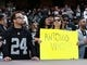 Sep 9, 2019; Oakland, CA, USA; An Oakland Raiders fan holds a sign reading to  Antonio who?  referring to the release of receiver Antonio Brown (not picture) before the game against the Denver Broncos at Oakland Coliseum. Mandatory Credit: Kelley L Cox-USA TODAY Sports