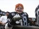 Sep 9, 2019; Oakland, CA, USA; An Oakland Raiders fan with a Chuckle mask before the game Denver Broncos at Oakland Coliseum. Mandatory Credit: Kelley L Cox-USA TODAY Sports