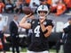 Sep 9, 2019; Oakland, CA, USA; Oakland Raiders quarterback Derek Carr (4) warms up before the game against the Denver Broncos at Oakland Coliseum. Mandatory Credit: Kelley L Cox-USA TODAY Sports