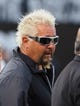 Sep 9, 2019; Oakland, CA, USA; Oakland Raiders fan Guy Fieri on the field before the game against the Denver Broncos at Oakland Coliseum. Mandatory Credit: Kelley L Cox-USA TODAY Sports