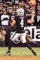 Sep 9, 2019; Oakland, CA, USA; Oakland Raiders quarterback Derek Carr (4) throws the ball against the Denver Broncos during the first quarter at Oakland Coliseum. Mandatory Credit: Kelley L Cox-USA TODAY Sports