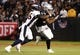 Sep 9, 2019; Oakland, CA, USA; Oakland Raiders tight end Darren Waller (83) carries the ball against Denver Broncos cornerback Isaac Yiadom (26) during the first quarter at Oakland Coliseum. Mandatory Credit: Kelley L Cox-USA TODAY Sports