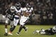 Sep 9, 2019; Oakland, CA, USA; Denver Broncos running back Royce Freeman (28) is pursued by Oakland Raiders cornerback Gareon Conley (21) and free safety Karl Joseph (42) at Oakland-Alameda County Coliseum. The Raiders defeated The Broncos 24-16.  Mandatory Credit: Kirby Lee-USA TODAY Sports