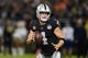 Sep 9, 2019; Oakland, CA, USA; Oakland Raiders quarterback Derek Carr (4) carries the ball in the second quarter against the Denver Broncos at Oakland-Alameda County Coliseum. Mandatory Credit: Kirby Lee-USA TODAY Sports