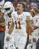 Sep 14, 2019; Houston, TX, USA; Texas Longhorns quarterback Sam Ehlinger (11) shouts before a game against the Rice Owls at NRG Stadium. Mandatory Credit: Troy Taormina-USA TODAY Sports