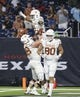 Sep 14, 2019; Houston, TX, USA; Texas Longhorns quarterback Roschon Johnson (2) celebrates with offensive lineman Derek Kerstetter (68) after scoring a touchdown during the first quarter against the Rice Owls at NRG Stadium. Mandatory Credit: Troy Taormina-USA TODAY Sports