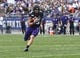 Sep 21, 2019; Evanston, IL, USA; Northwestern Wildcats quarterback Hunter Johnson (15) runs against the Michigan State Spartans during the first half at Ryan Field. Mandatory Credit: Matt Marton-USA TODAY Sports